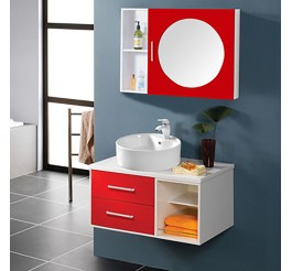 Bright red bathroom vanity with a middle round mirror